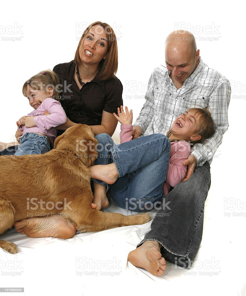 Young Family of for Whith Their Dog royalty-free stock photo