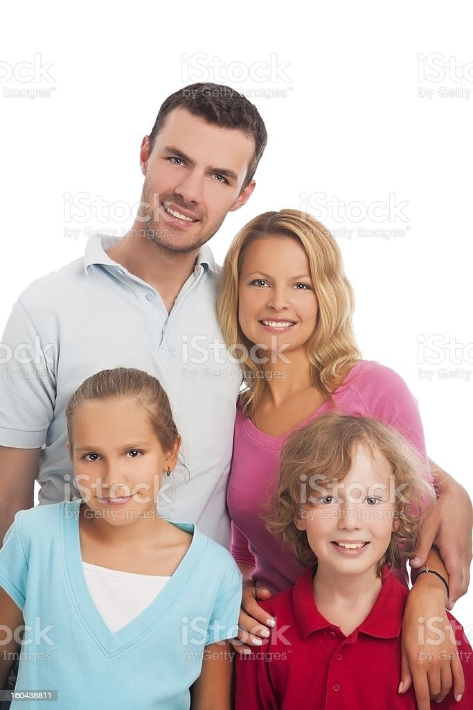 young family of four people standing together royalty-free stock photo