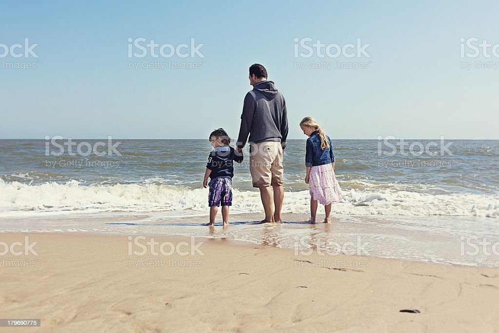 Young Family on Beach royalty-free stock photo