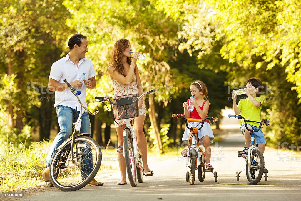 Young family on bicycles in park stock photo