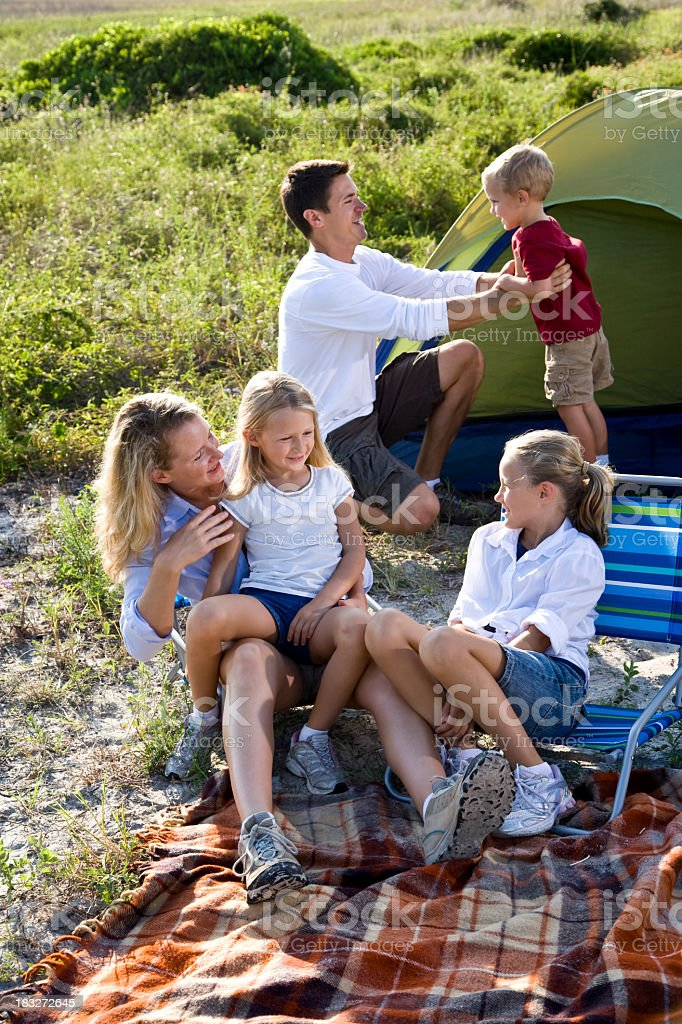 Young family on camping trip with tent royalty-free stock photo