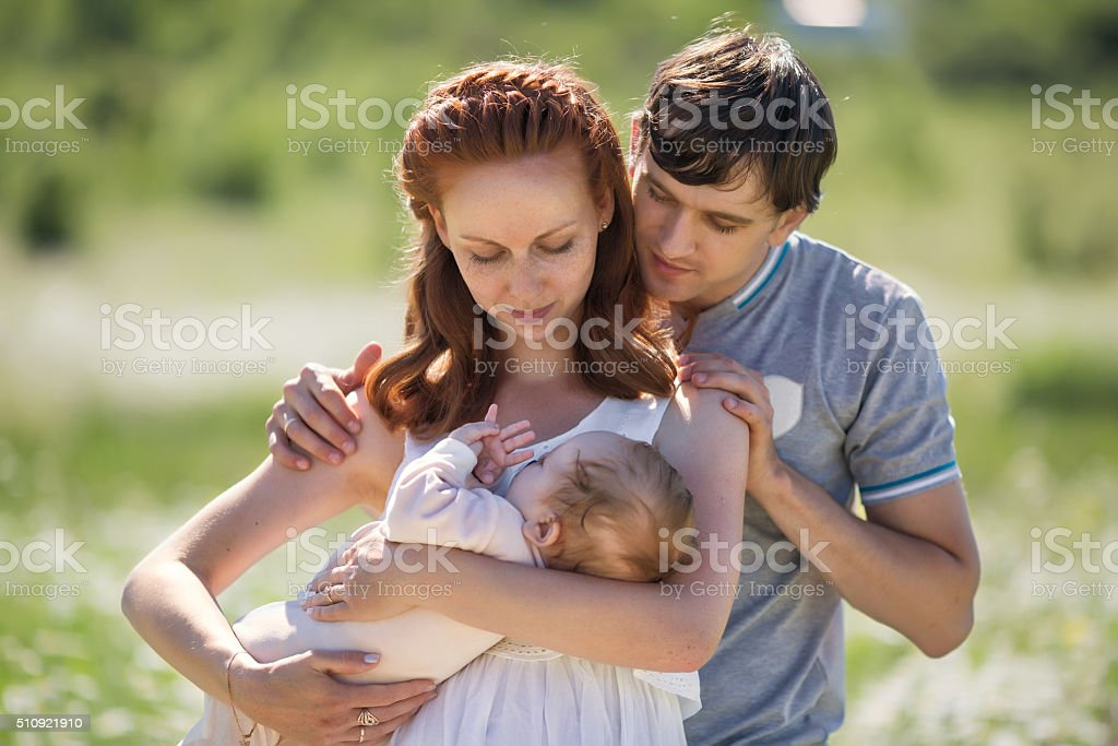 Young family on field stock photo
