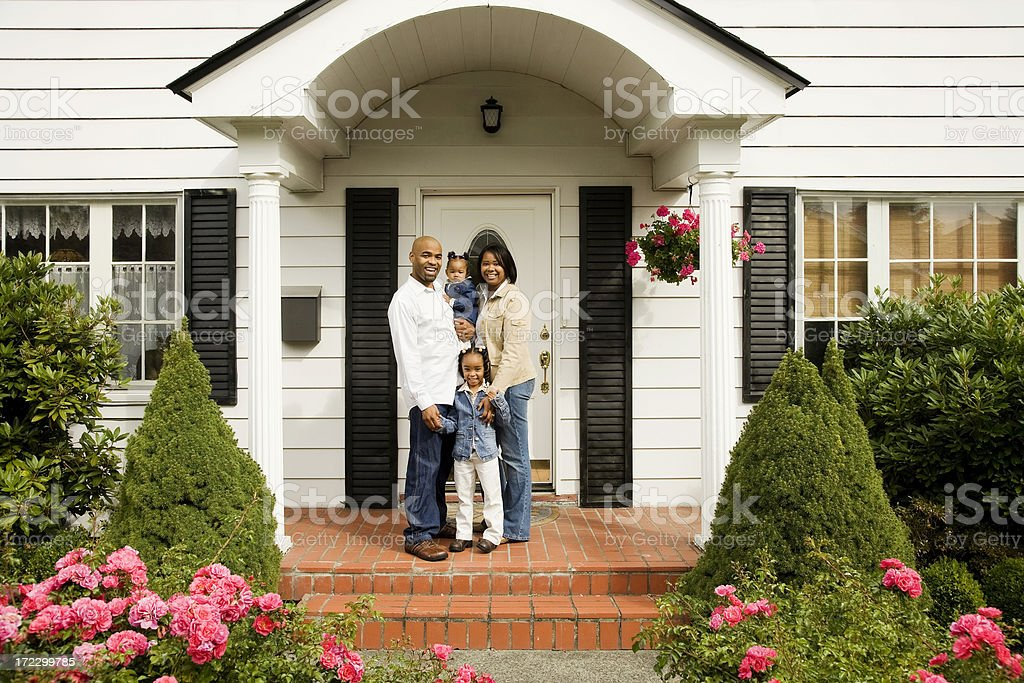 Young Family on Front Porch stock photo