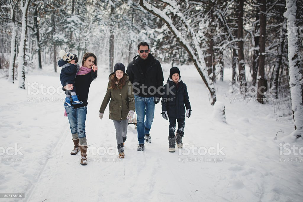 Young Family on the snow stock photo