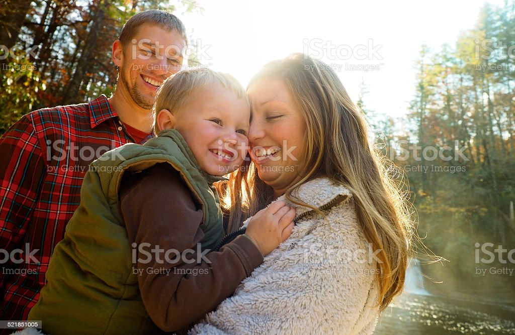 Young Family Outdoors In Autumn stock photo