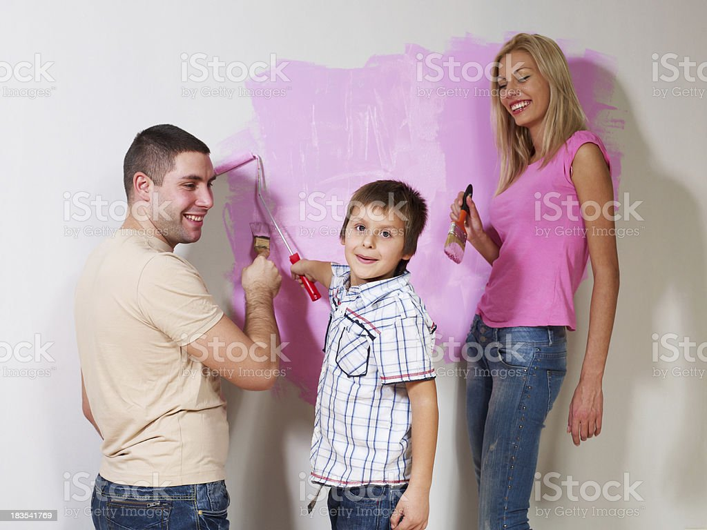 Young family painting the wall royalty-free stock photo
