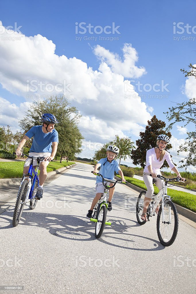 Young Family Parents and Boy Son Cycling royalty-free stock photo