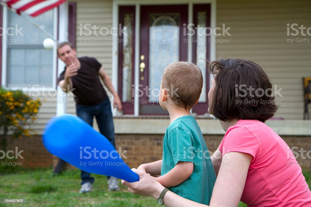 Young family play baseball royalty-free stock photo