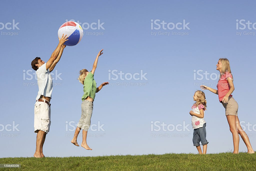 Young family playing in field royalty-free stock photo