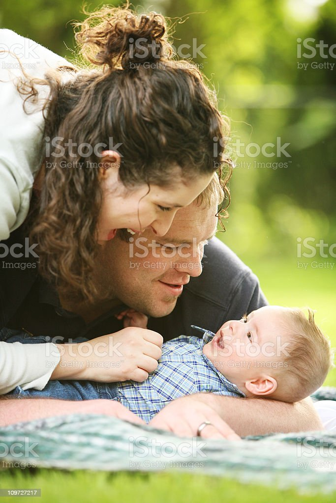 Young Family Playing with their Son royalty-free stock photo