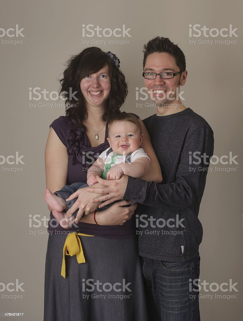 Young Family Posing for Portrait on Backdrop royalty-free stock photo