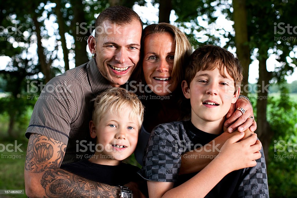 Young Family Posing In A Park royalty-free stock photo
