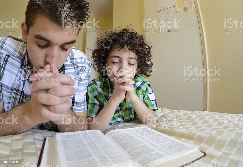 Young Family Praying royalty-free stock photo
