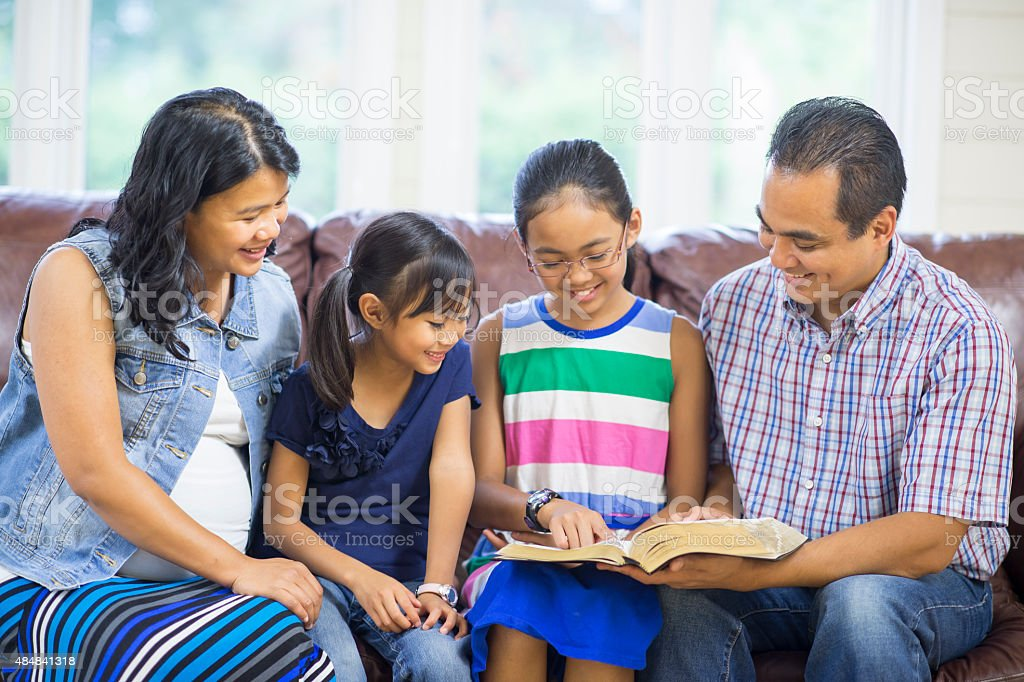 Young family praying stock photo