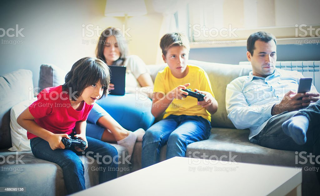 Young family relaxing at home. stock photo