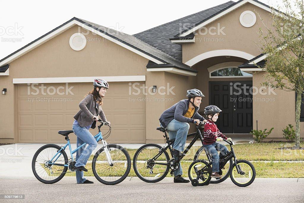 Young family riding bikes stock photo