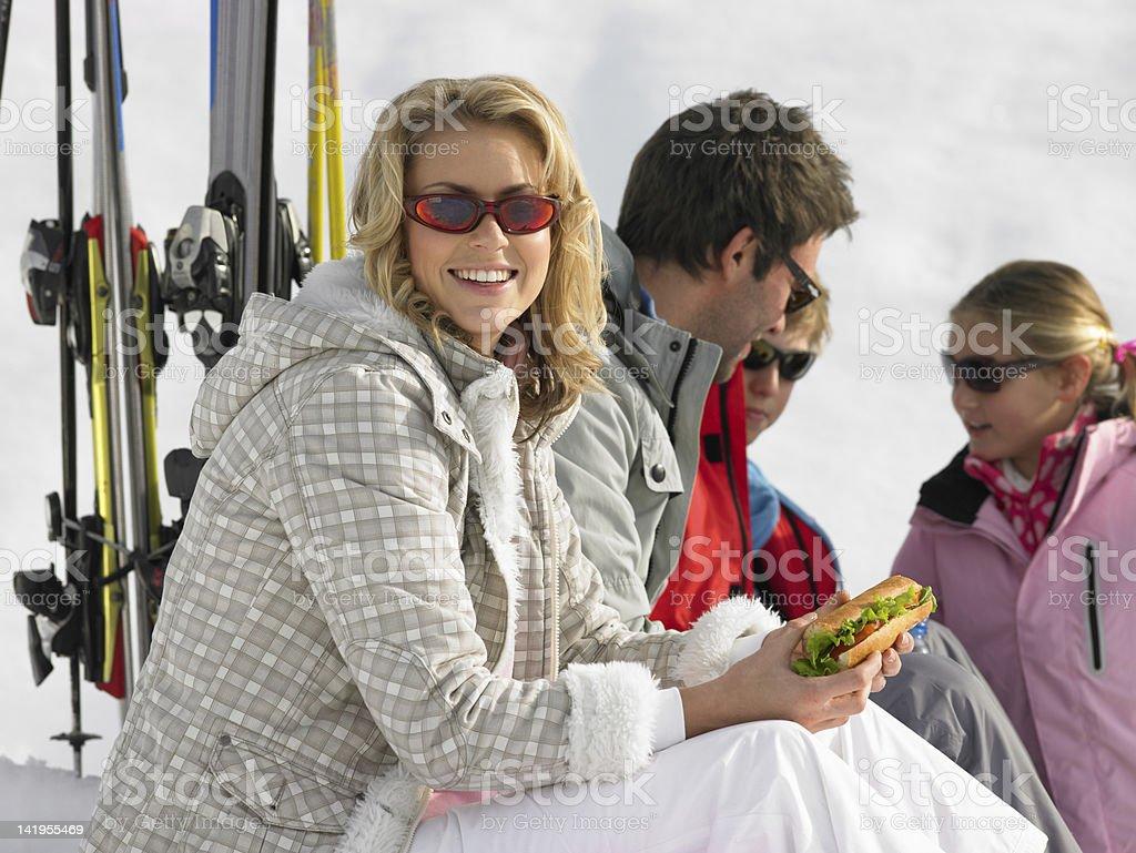 Young Family Sharing A Picnic On Ski Vacation royalty-free stock photo