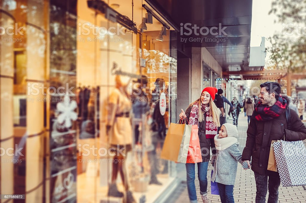 Young family shopping for Christmas stock photo