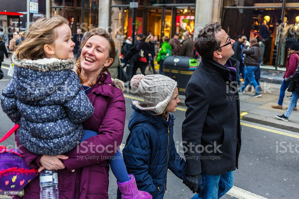 Young Family Sightseeing and Shopping at Christmas Markets stock photo