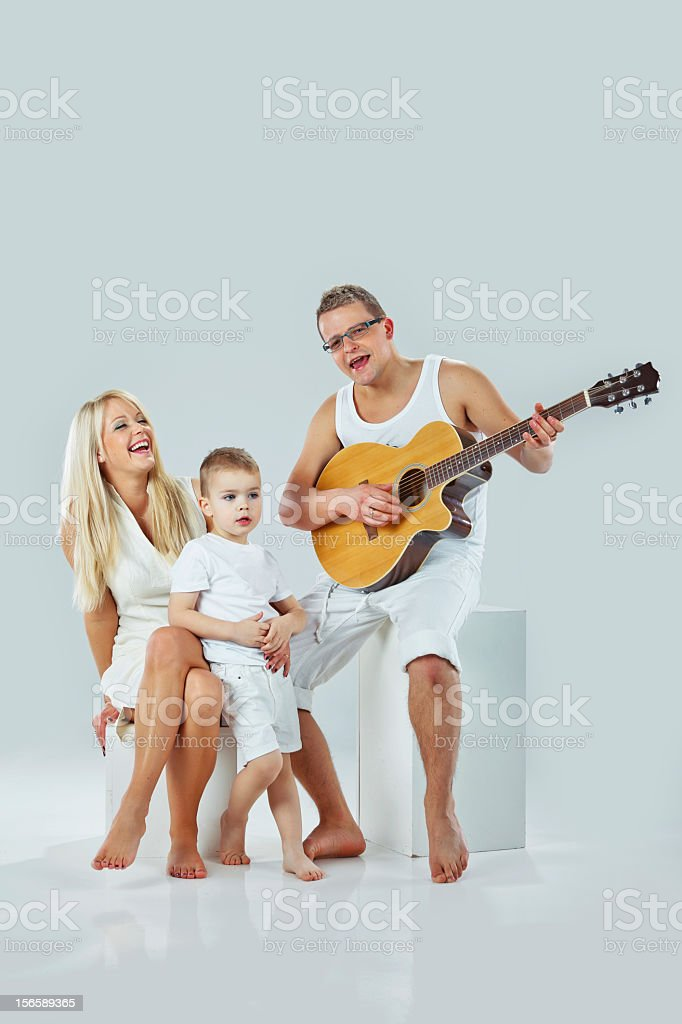 Young family singing royalty-free stock photo