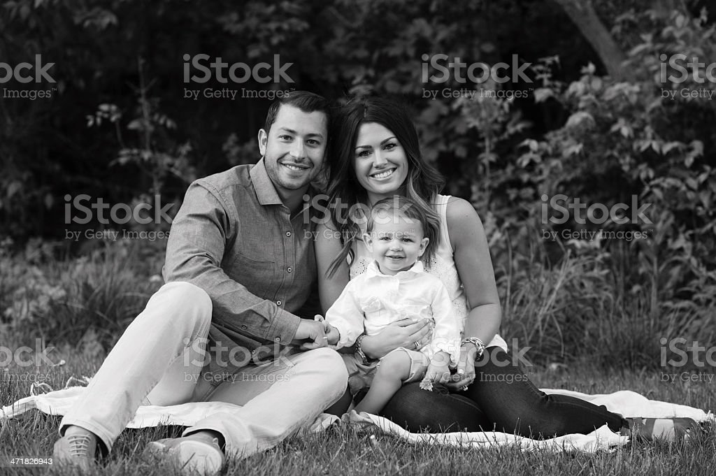 Young Family Sitting on Grass royalty-free stock photo