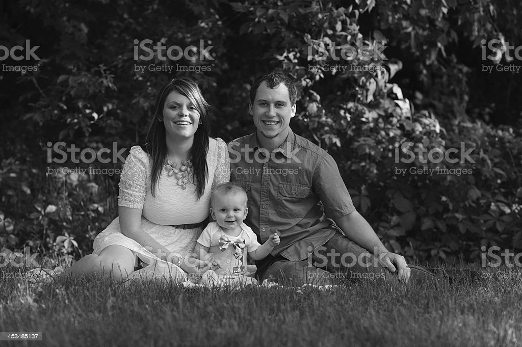 Young Family Sitting Outside on Blanket royalty-free stock photo