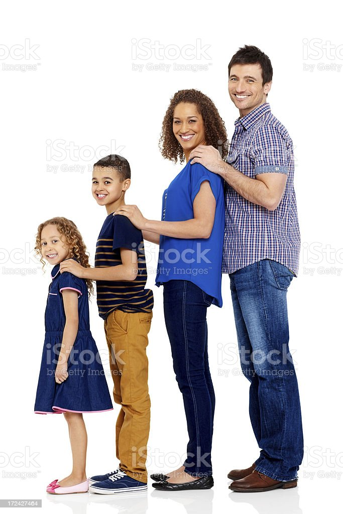 Young family standing together in line smiling royalty-free stock photo