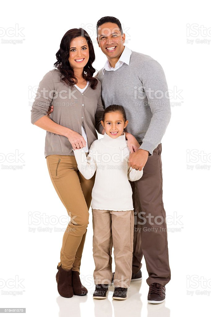 young family standing together stock photo