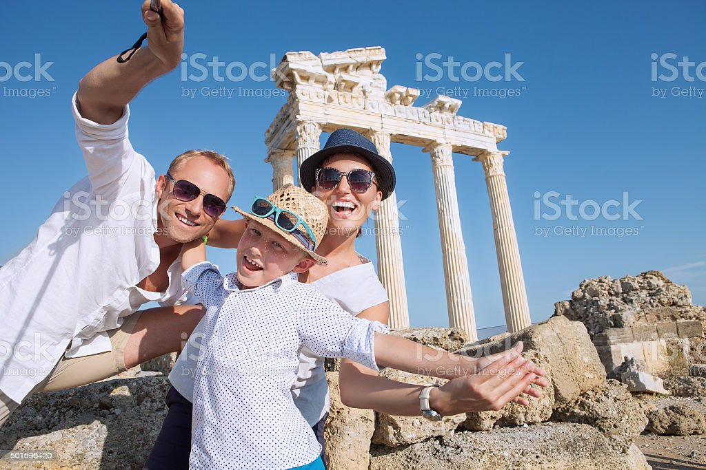 Young family take a vacation selfie on antique sights view stock photo