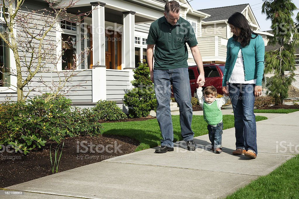 Young Family Taking a Stroll royalty-free stock photo