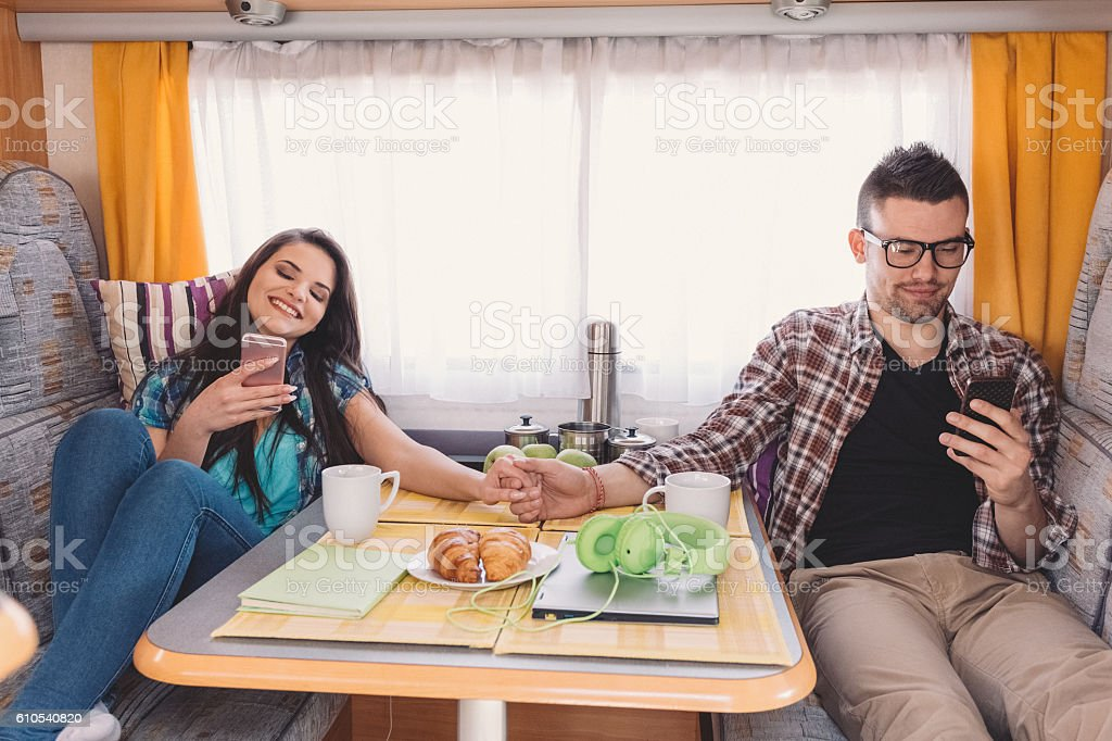 Young family traveling in campervan stock photo