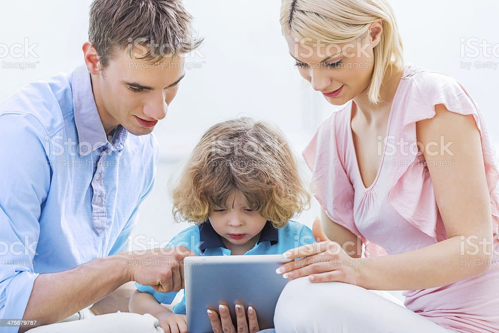 Young family using touchpad. royalty-free stock photo