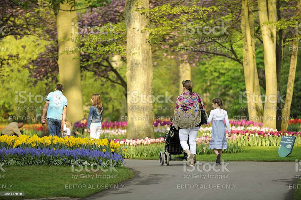 Young family visiting flower park Keukenhof in the Netherlands royalty-free stock photo