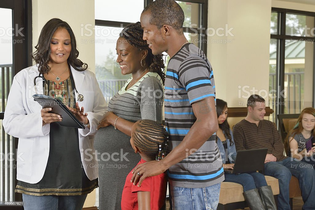 Young Family Visiting OB/GYN Doctor stock photo