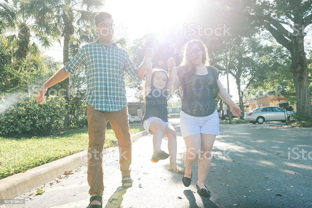 Young Family Walking in Winter Park Neighborhood Orlando Florida stock photo