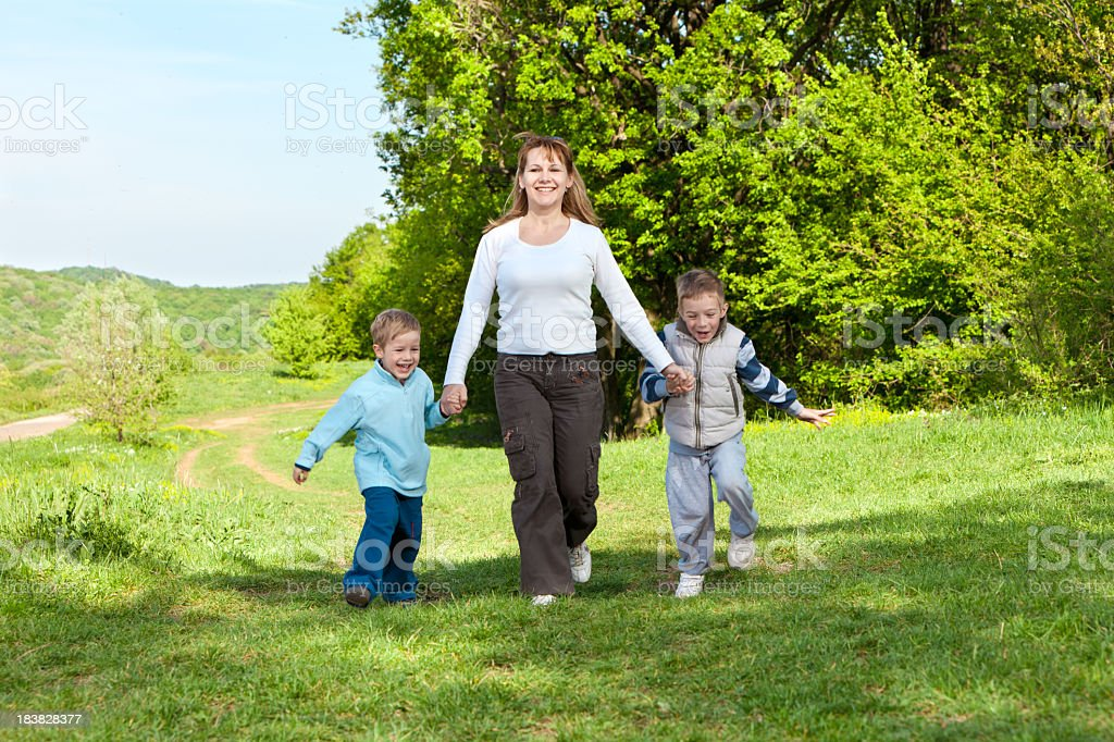 Young family walking outdoors on spring day royalty-free stock photo