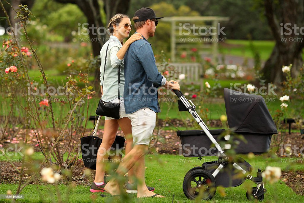 Young family walking with stroller stock photo
