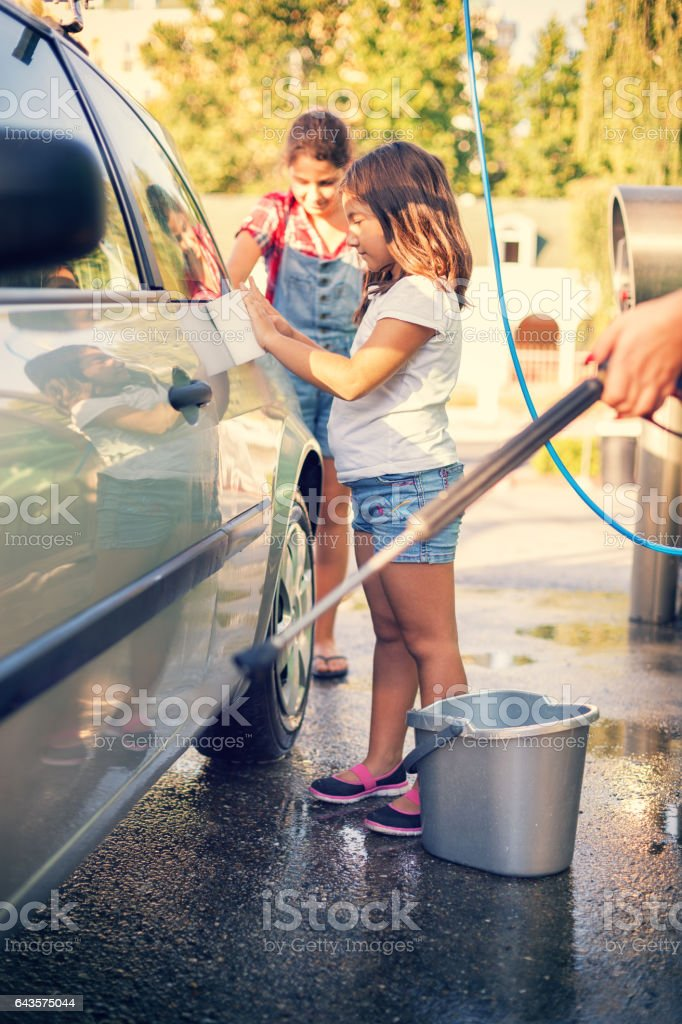 Young Family Washing The Car stock photo