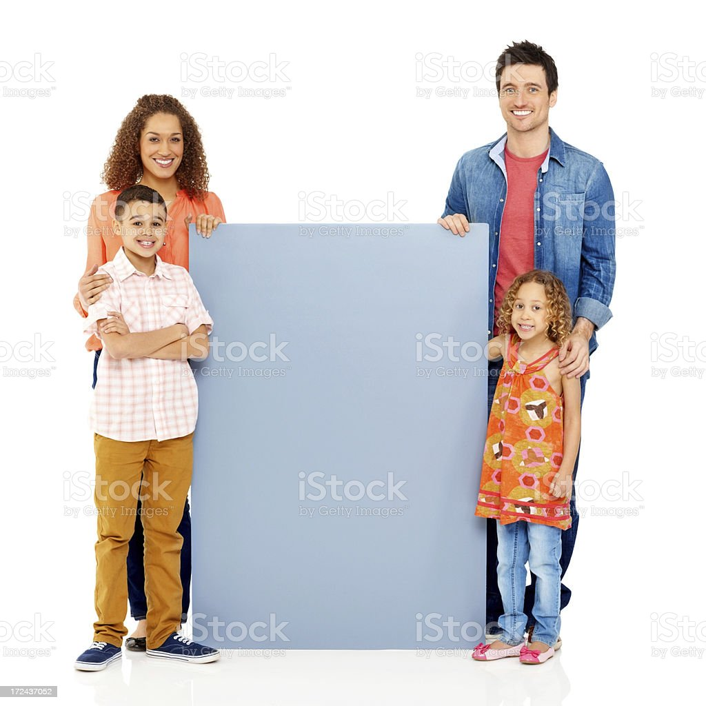 Young family with a blank billboard over white royalty-free stock photo