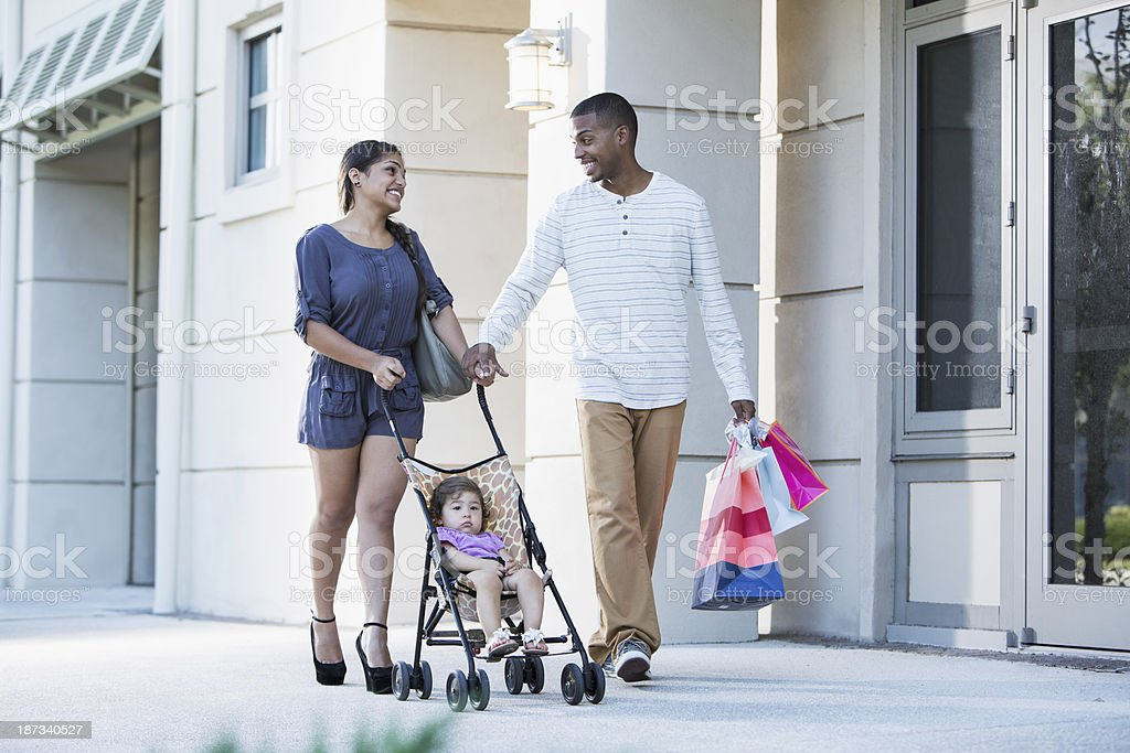 Young family with baby in stroller, shopping royalty-free stock photo