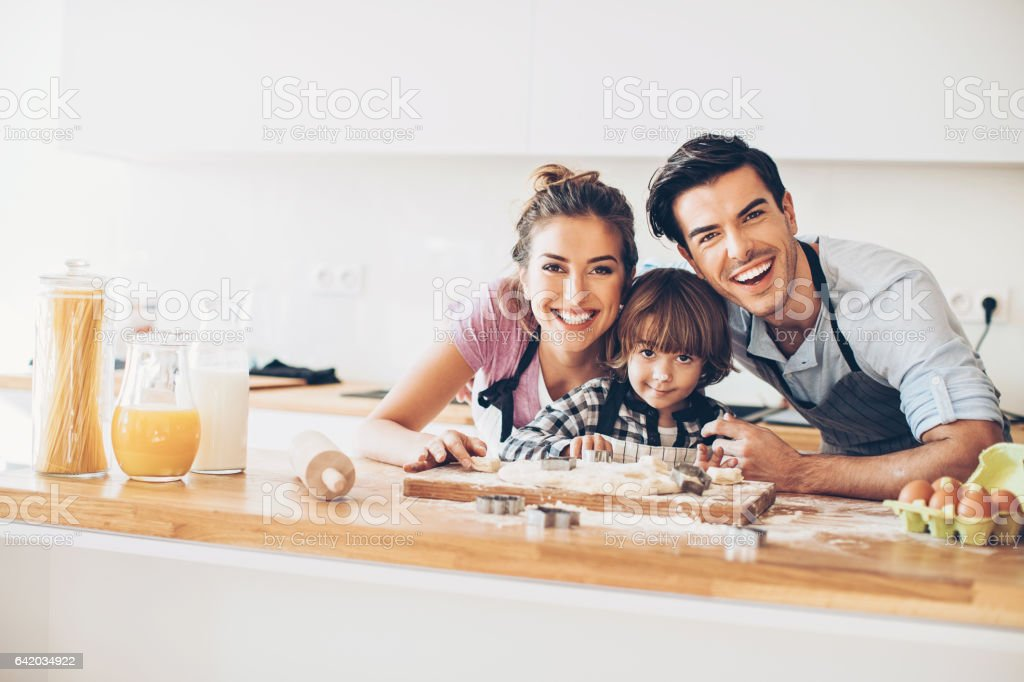 Father, mother and son making cookies