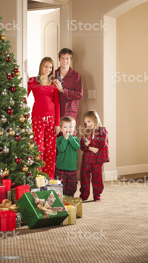 young family with two little kids on Christmas morning royalty-free stock photo