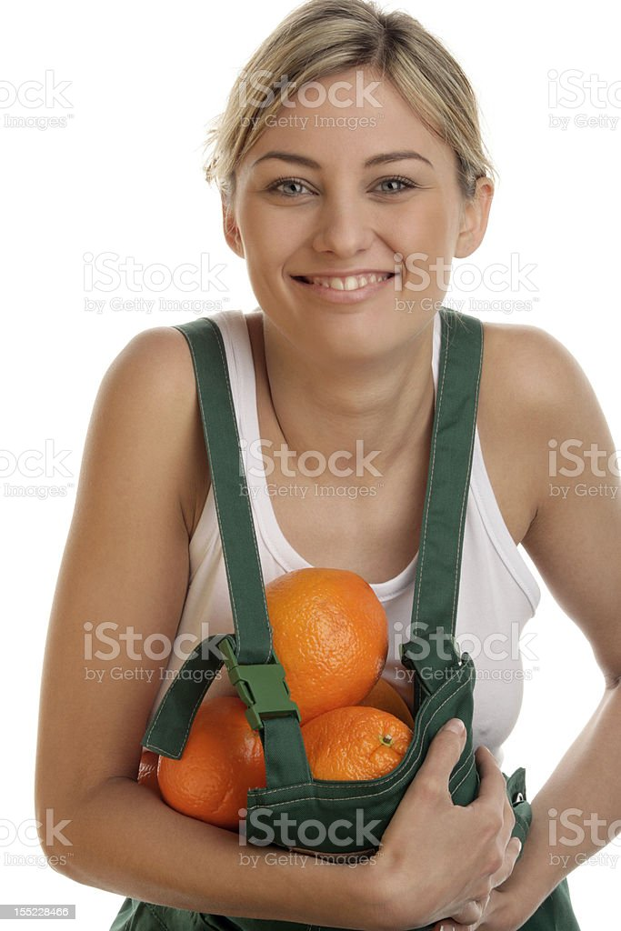 Young farm woman holding fresh oranges royalty-free stock photo