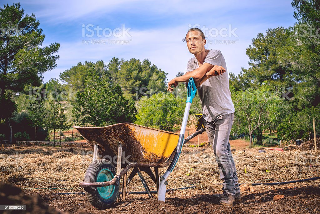 Young Farmer getting ready for Organic Agriculture stock photo