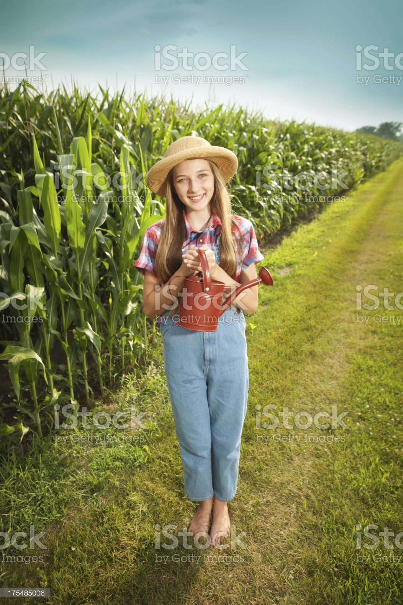 http://media.istockphoto.com/photos/young-farmer-girl-holding-watering-can-by-the-field-picture-id175485006?s=2048x2048