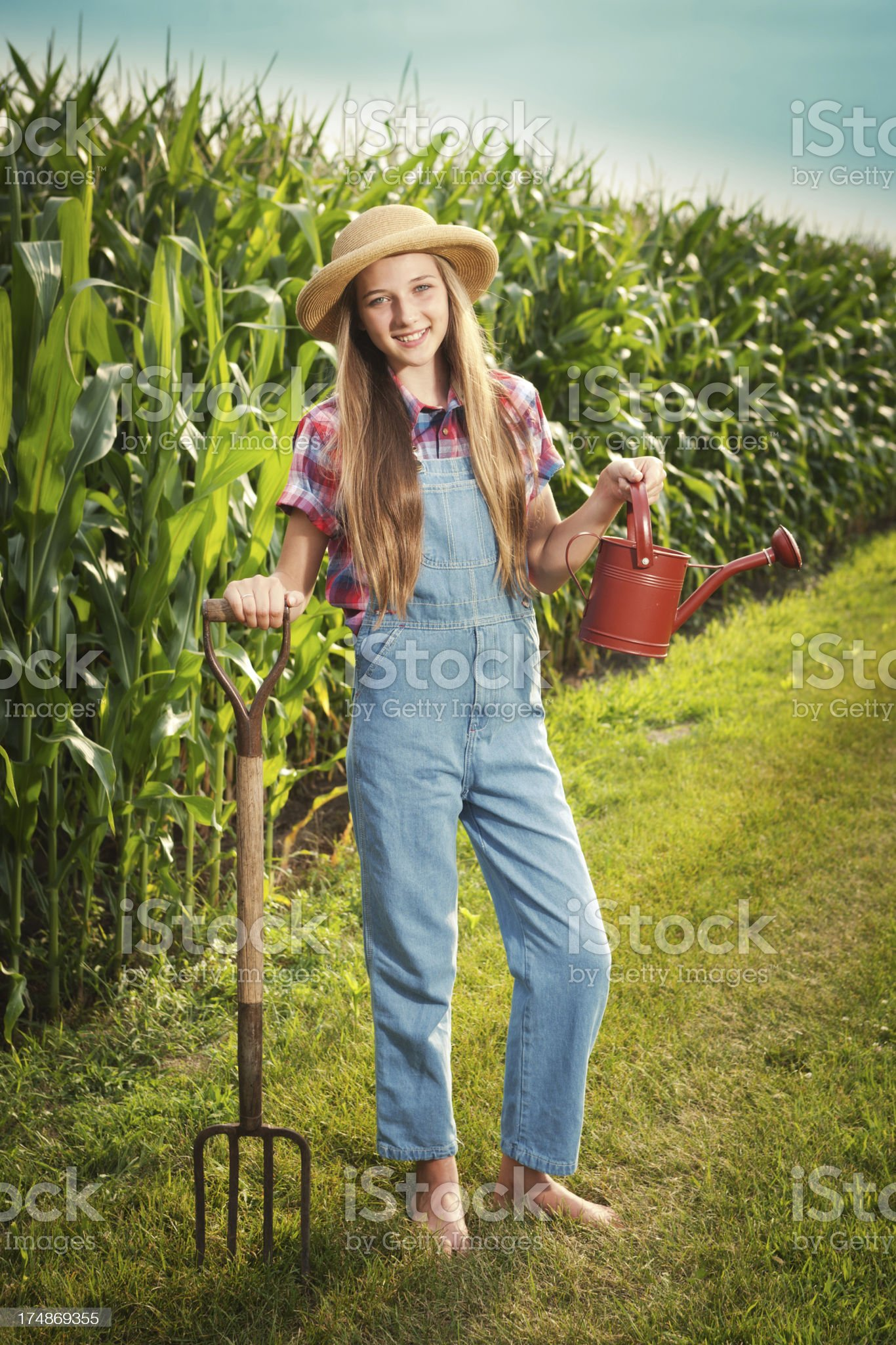 http://media.istockphoto.com/photos/young-farmer-girl-holding-watering-can-by-the-field-vt-picture-id174869355?s=2048x2048