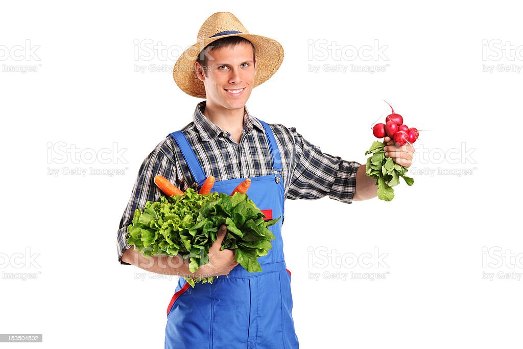 Young farmer holding vegetables royalty-free stock photo
