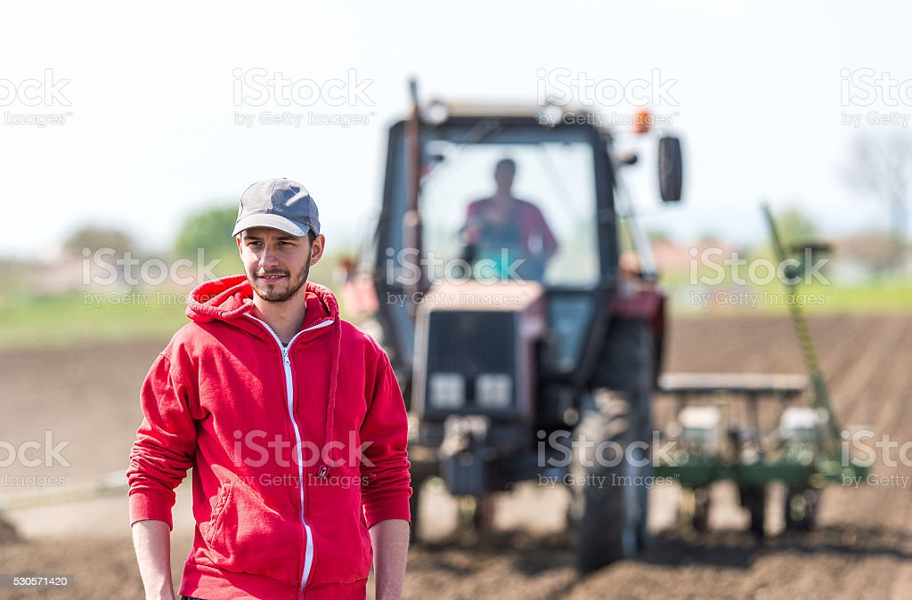 young farmer on farmland stock photo