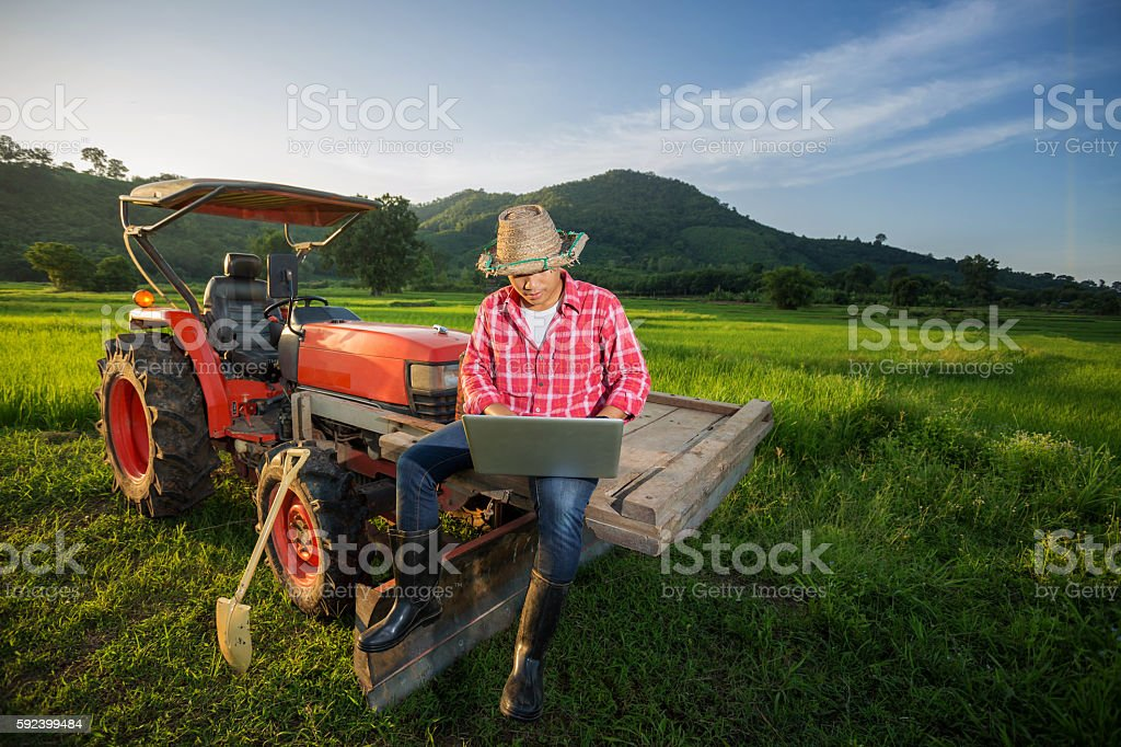 Young Farmer recorded growth of productivity sitting stock photo