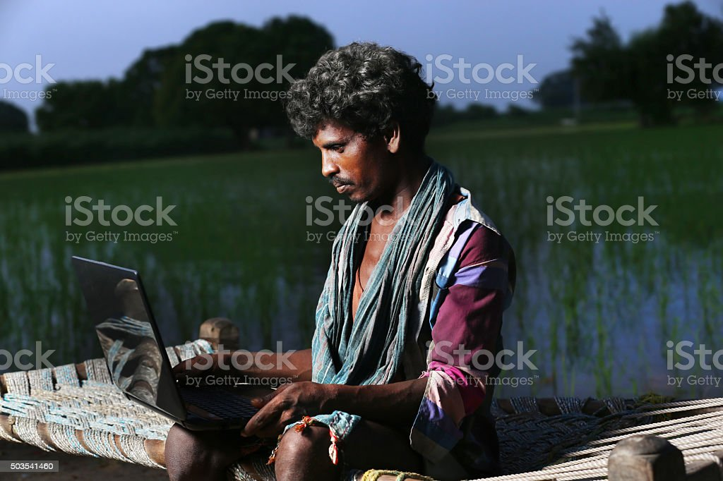 Young Farmer Using Laptop stock photo